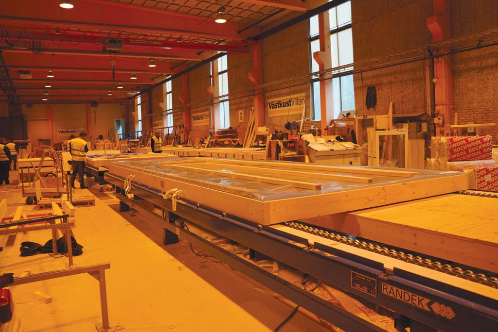 Wall panels being manufactured at the VästkustStugan plant.