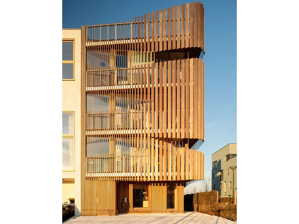 Freebooter: A slatted-wood facade enables optimal distribution of natural light while enhancing required levels of privacy. The building's hybrid structure, comprising CLT and steel, was prefabricated offsite, enabling a construction time of six months. Image credit: Francisco Nogueira
