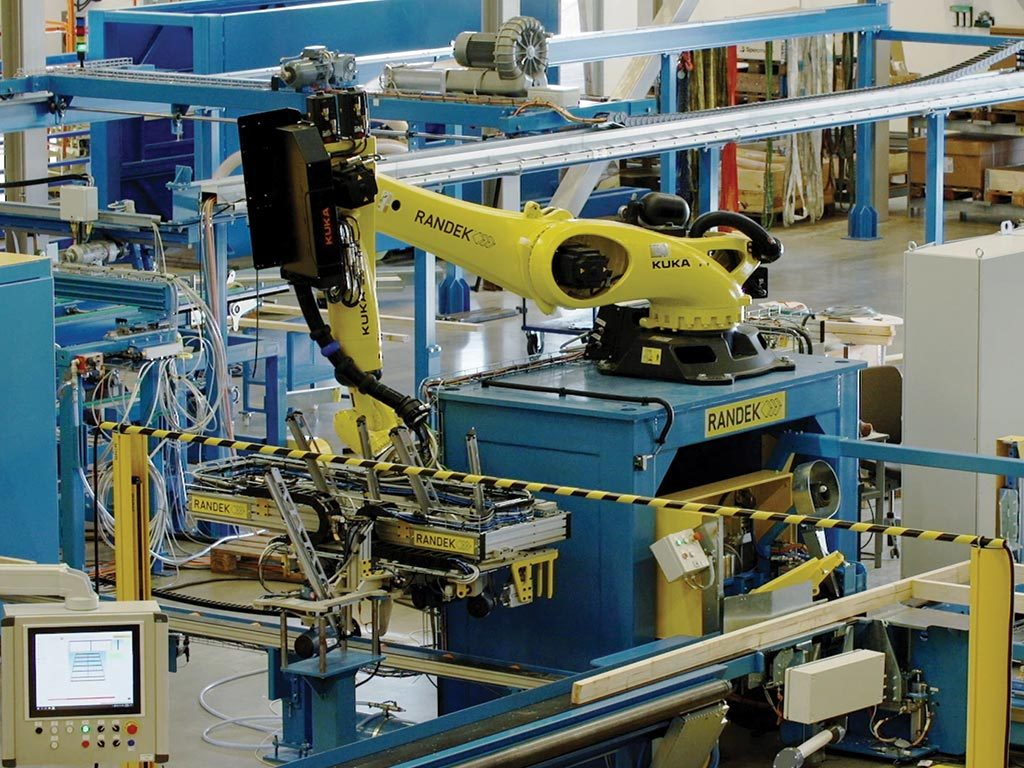 The Randek AutoWall System uses extensive automation including a robot to manufacture wall frames with noggins